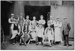 Photo C. 1910 – George Kay (right) and staff, probably at North Inglis Street workshop
