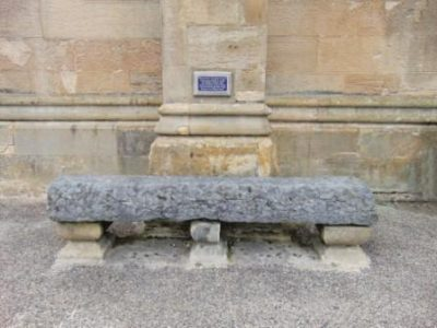 Photo of a seat outside Dunfermline Abbey Church, believed to have been made from a piece of the original shrine to st. Margaret