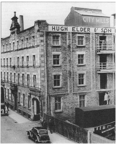 Photo of Elder's Inglis Street City Mill c. 1950. Note the sacks being hoisted on right from a railway van.