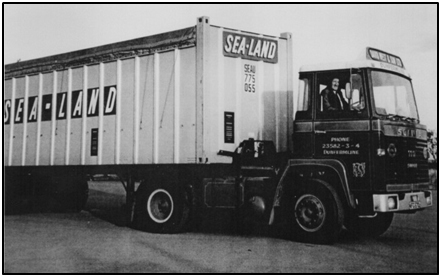 Photo circa 1973 of Jim West at the wheel of a new Scania tractor unit loaded with a Sea-Land container unit.