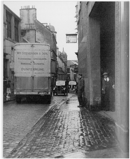 Photo of one of Stevenson's removal vans making a tight turn into the firm's loading bay at Bruce Street