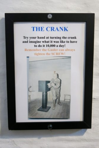 Poster showing a crank to work convicts