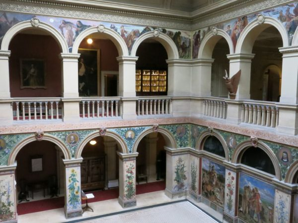 Photo of the central hall with murals
