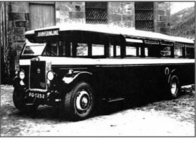 Photo of C. 1920 An early Jackson bodied bus outside the Mill St premises