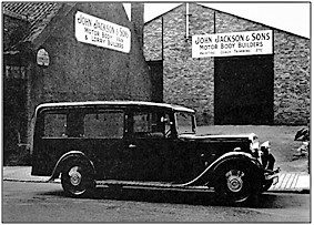 Photo C. 1935 – A Jackson bodied hearse outside the new Pittencrieff Street premises