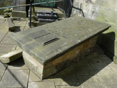 Photo of the original gravestone outside the Erskine Church