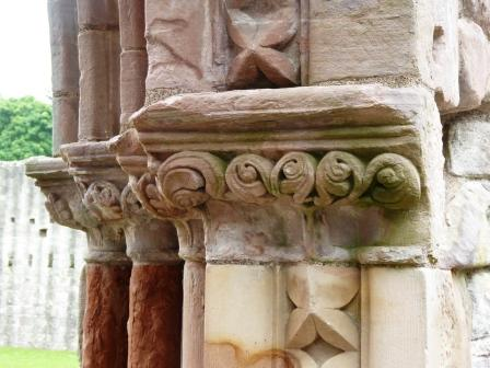 Photo of Stone carving on the doorway to the Abbey from the cloister