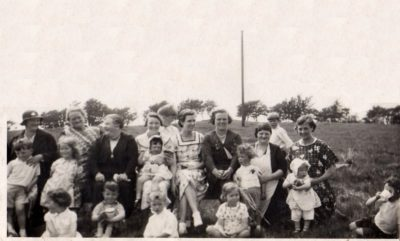 Photo of a group of women and children at a Lassodie picnic/gala, including Peggy's mother with Peggy, aged around two years, on her knee
