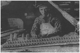 Photo of Henry Richmond at work in his James Place premises c.1936