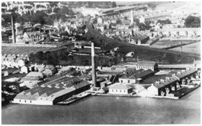 Photo of the Elgin Rubberworks c.1920 to the immediate left of the factory chimney in the foreground