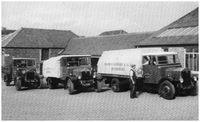 Photo of three of Stewart's Albion motor lorries outside the rubber works c.1935