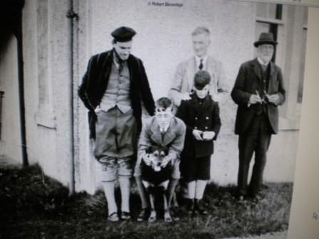 Photo of William Beveridge, centre, Erskine Beveridge, right, in a family group on Vallay